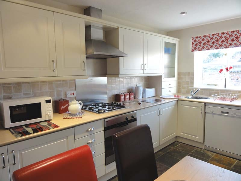 The kitchen in this cottage has all the equipment necessary to cater for a family holiday